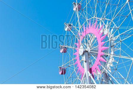 Ferris wheel in bluesky for copy space