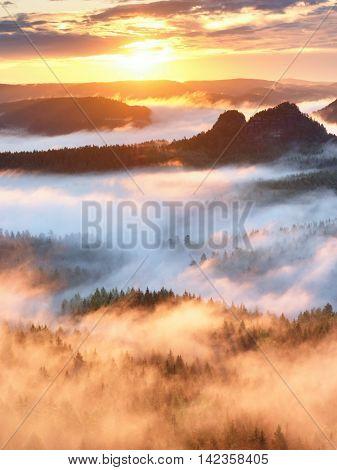 Red Filter Photo. Dark Peaks Of Hills In Misty Malley