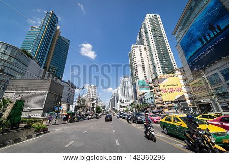 Bangkok, Thailand - October 31, 2015: Asoke on October 31, 2015. Cars and Motorcycle are waiting for the green light on Asoke Junction.