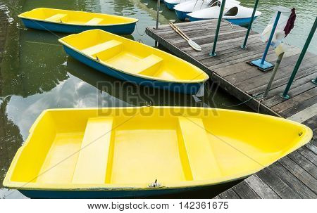 Yellow Rowing Boat pier in Bangkok park