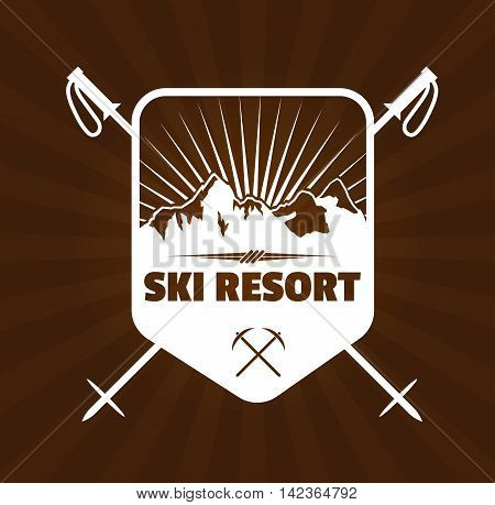 Vintage skiing resort or mountain patrol label, emblem or logo with mountain and ski poles