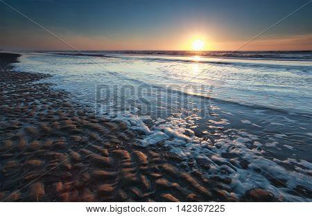 summer sunset on North sea beach Holland