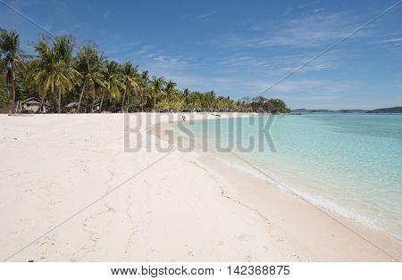 Deserted tropical beach on a small island