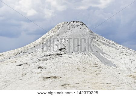 Mud volcanoes also known as mud domes erupting in summer landscape