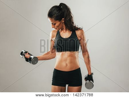 Fit Woman Lifting Chrome Dumbbell Weights