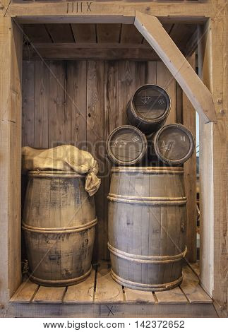 Five wood cask barrel of different sizes