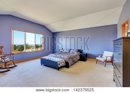 Spacious Blue Bedroom With Vaulted Ceiling