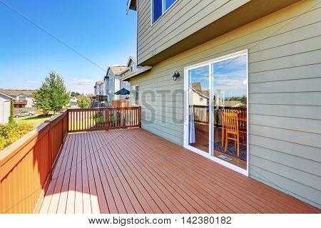 Empty Wooden Walkout Deck With Neighborhood View