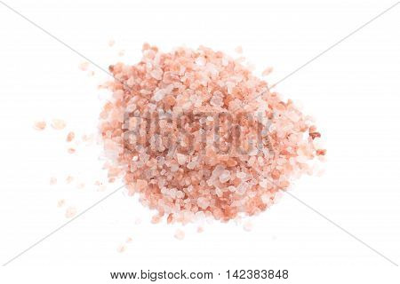 Himalayan pink salt in white background. Close-up