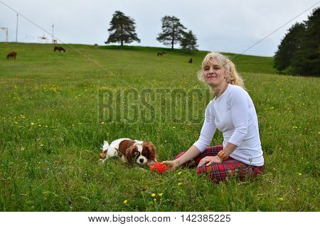 Dog And Lady Playing