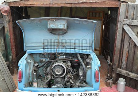 MOSCOW - MAR 9, 2015: Zaporozhec, rear-passenger compact car, open hood, engine can be seen, antique Car Museum at Rogozhsky val street
