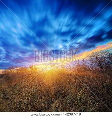 Long exposure work during sunsrise. Motion of clouds