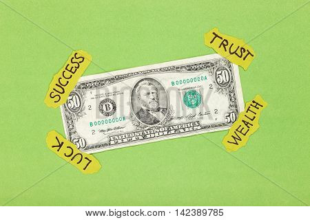 Dollar attached on green background with paper symbol sticks. Creative money concept
