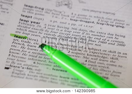The word learn is highlighted and defined in a dictionary.