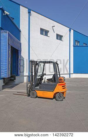 Forklift Truck at Distribution Warehouse Loading Dock