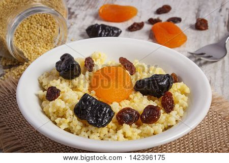 Cooked Millet Groats On White Plate, Healthy Food And Nutrition