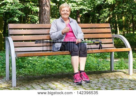 Senior Woman Resting After Nordic Walking And Showing Thumbs Up, Sporty Lifestyles