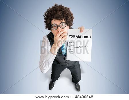 Disappointed Employee Is Showing Letter With You Are Fired Messa