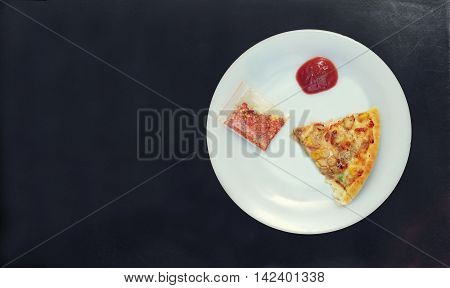 single slice corn pizza with tomato ketchup
