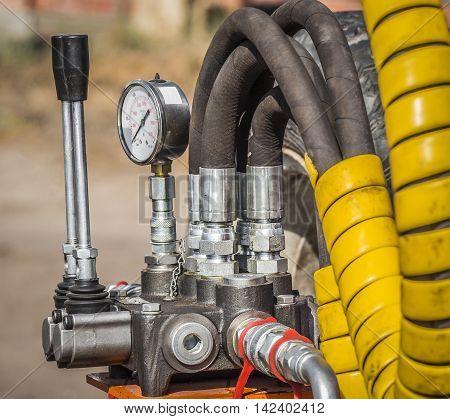 Control levers and pressure control unit of the hydraulic machine closeup