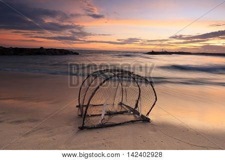 The old trap on low tide beach when twilight in Thailand