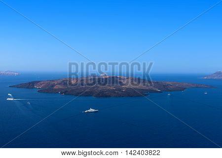 Santorini's famous Volcano, located in front of Santorini's cliff