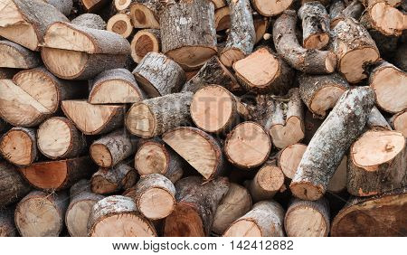 Firewood background prepare the surface by sawing machine.