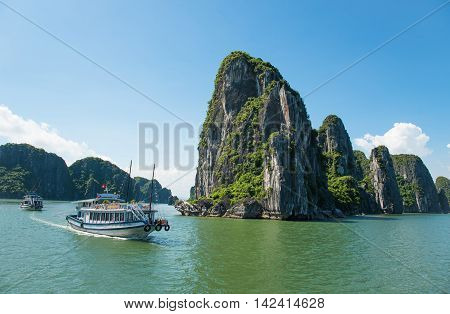 Beautiful travel view in the Halong Bay Vietnam landscape ocean and limestone mountain on blue sky background.