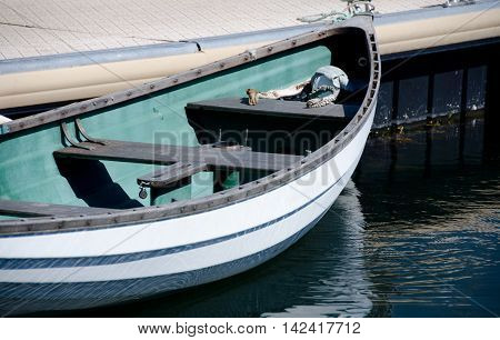 White Rowboat Parked In Victoria Bay, British Columbia
