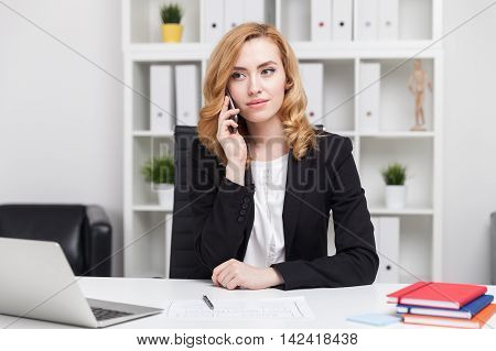 Business Lady Talking On Her Phone And Looking Serious