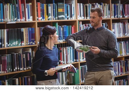 Mature students interacting with each other in college library