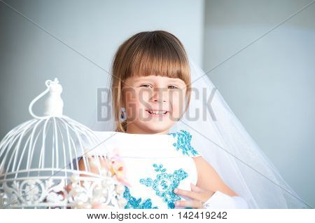 Close portrait of a little girl in a magnificent evening dress