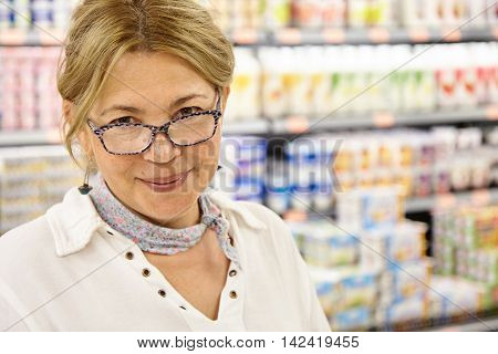 Headshot Of Mature Caucasian Female Customer Walking About Hypermarket Shopping Around Looking For F