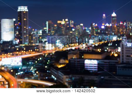Abstract blurred bokeh lights city office building night view