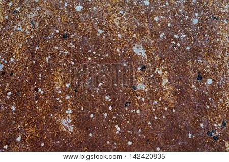 Vintage rusty iron wall with many stains of paint
