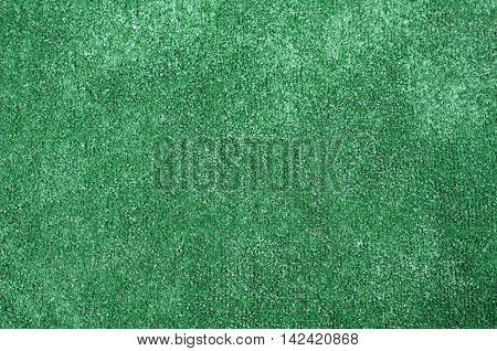 Background of green plastic artificial grass texture