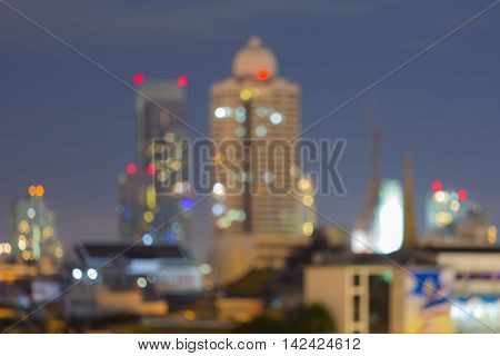 Blurred lights city office building with twilight background