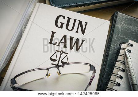 Gun law book. Justice and legislation concept.