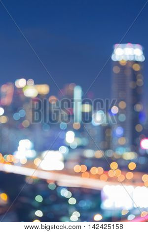 Blurred lights over city downtown, night view, abstract background