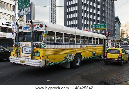 Panama City, Panama - March 18, 2014: A Red Devil Bus (Diablo Rojo) in Panama City. Red Devil buses are public trasports painted in bright colors and symbols.