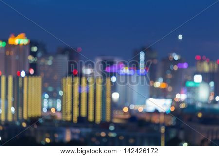 Twilight night view, abstract blurred city downtown background