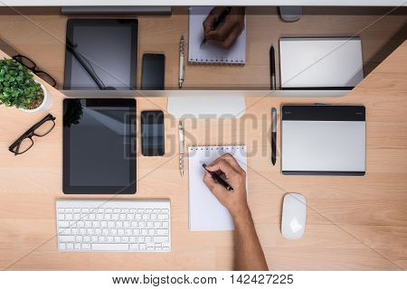 Top View Office Hand Working Write Paper Note