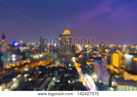 Twilight city blurred lights night view, abstract background