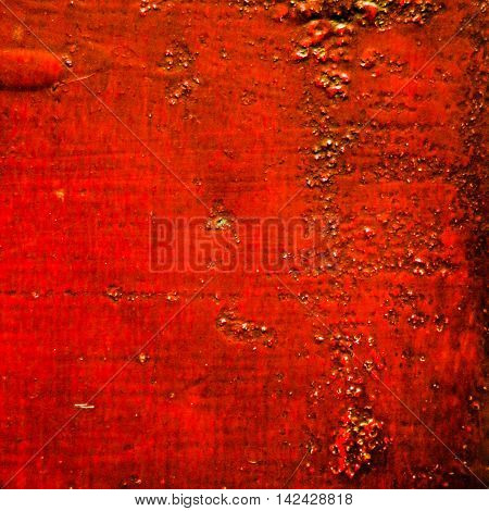 Textured dirty and worn bumpy red background in square format.