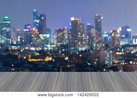 Opening wooden floor, abstract blurred light city office building at twilight