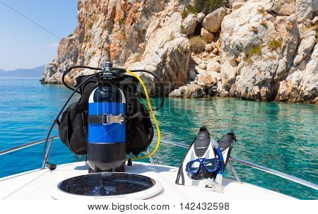 Scuba diving equipment standing on a boat in the mediterranean sea