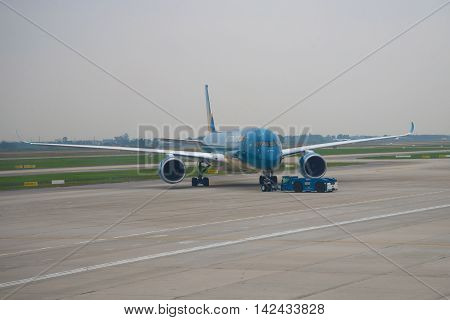 HANOI VIETNAM - JANUARY 12 2016: Towing of the Airbus A350 (VN-A888) Vietnam Airlines on the runway of Noi Bai airport