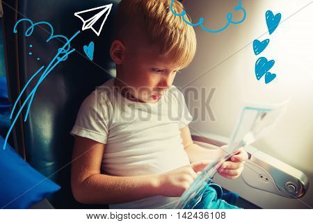 Boy Sit Airplane Window Reads Paper Travel Concept