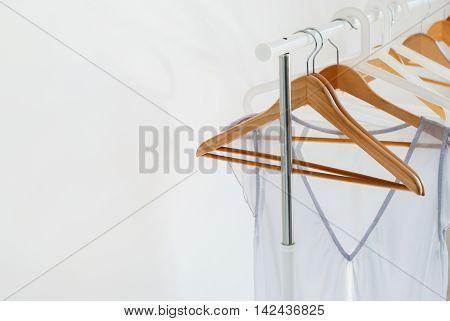 Empty Open Cloth Rail Grey Dress Wooden Hangers