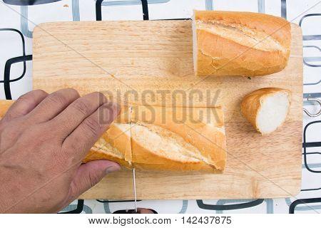 Chef slicing bread / cooking sausage bread concept